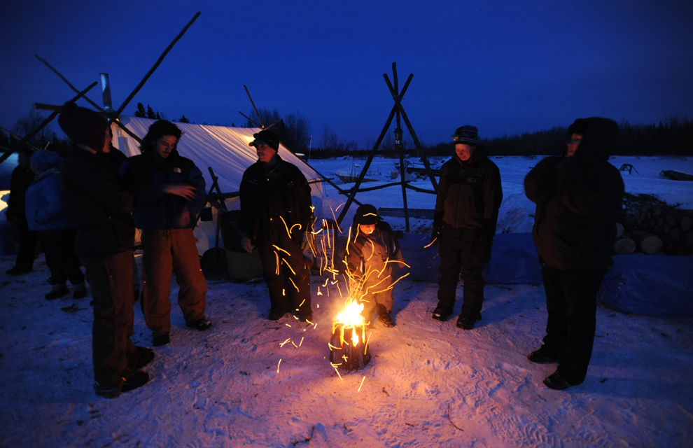Men around campfire